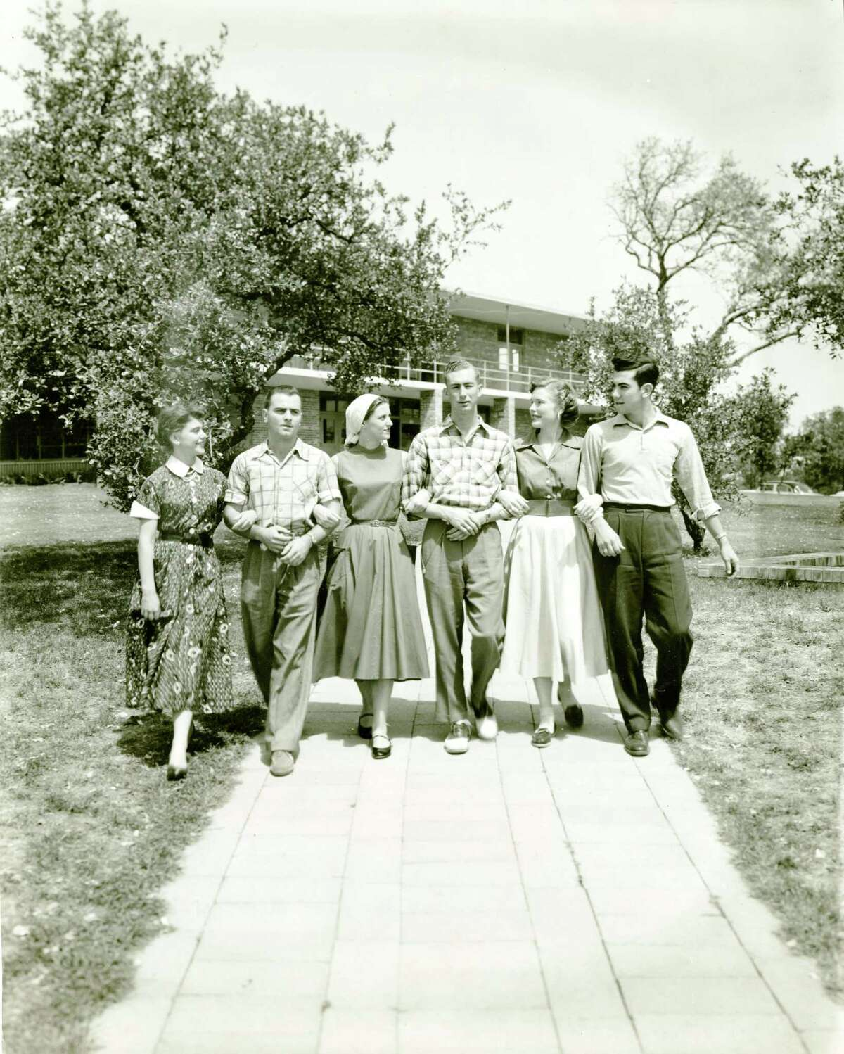 A campus scene circa 1955 with students in the vicinity of Storch Memorial Building at Trinity University.