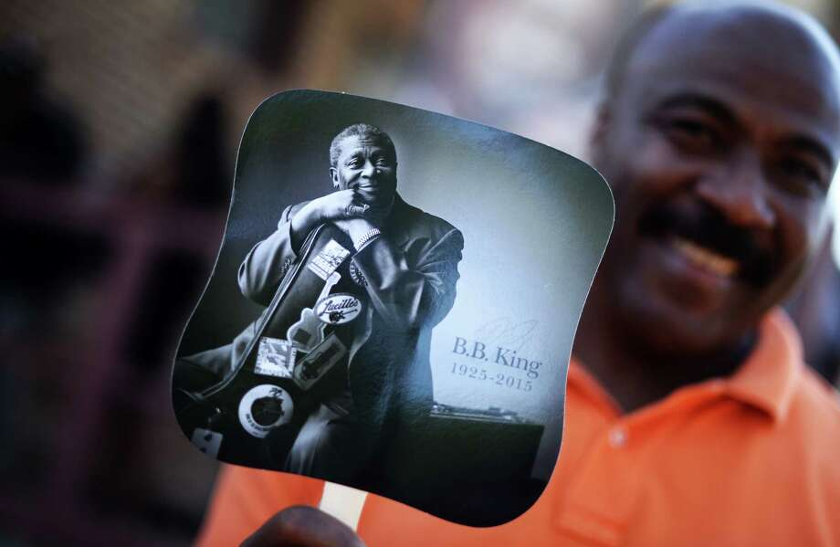 A man holding a hand-fan featuring a picture of blues legend B.B. King waits outside the B.B. King Museum and Delta Interpretive Center in Indianola, Mississippi, on May 29, 2015 during a public wake. Several thousands of fans gathered to pay their respect to King, who died on May 14 at the age of 89 in Las Vegas. AFP PHOTO/JEWEL SAMADJEWEL SAMAD/AFP/Getty Images Photo: JEWEL SAMAD, Staff / AFP / Getty Images / AFP
