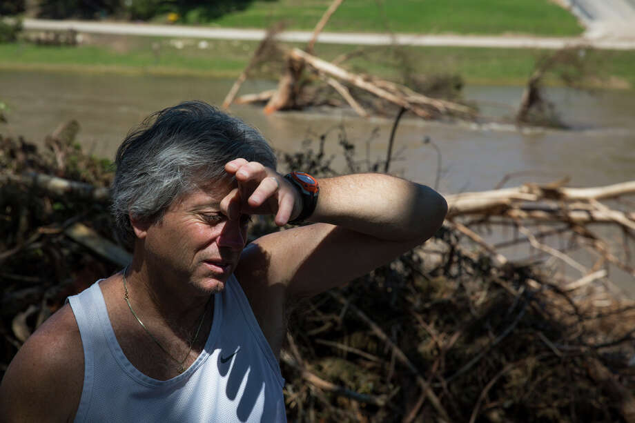 Brian Martinez wipes sweat from his face as he looks at the flood damage in his yard in Wimberley, Texas on Friday, May 29, 2015. Photo: Carolyn Van Houten, Staff / San Antonio Express-News / 2015 San Antonio Express-News