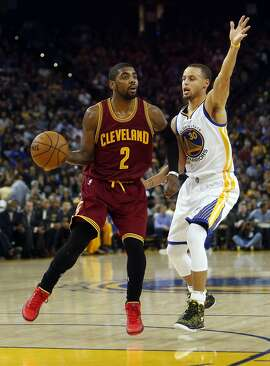 Cleveland Cavaliers' Kyrie Irving against Golden State Warriors' Stephen Curry during NBA game at Oracle Arena in Oakland, Calif. on Friday, January 9, 2015.