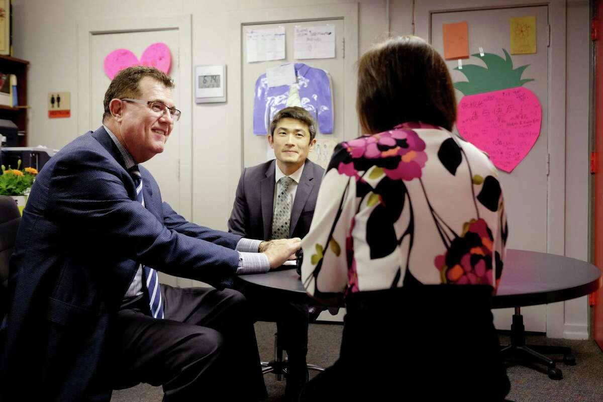 From left, HISD Superintendent Terry Grier meets with Principal Chaolin Chang and magnet coordinator Ginny Liang at the Mandarin Chinese Immersion School.