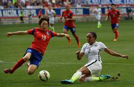South Korea's Kim Doyeon (19) stops a shot from Sydney Leroux (2) of the US during the friendly match between the USA and South Korea at Red Bulls Arena in Harrison, New Jersey on May 30, 2015. AFP PHOTO/ DON EMMERTDON EMMERT/AFP/Getty Images