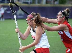 Niskayuna's #22 Catherine Sexton, left, gets by Somers' #3 Gabby Rosenzweig to score during their Class B girls' lacrosse regional final Saturday May 30, 2015 in Albany, NY.  (John Carl D'Annibale / Times Union)