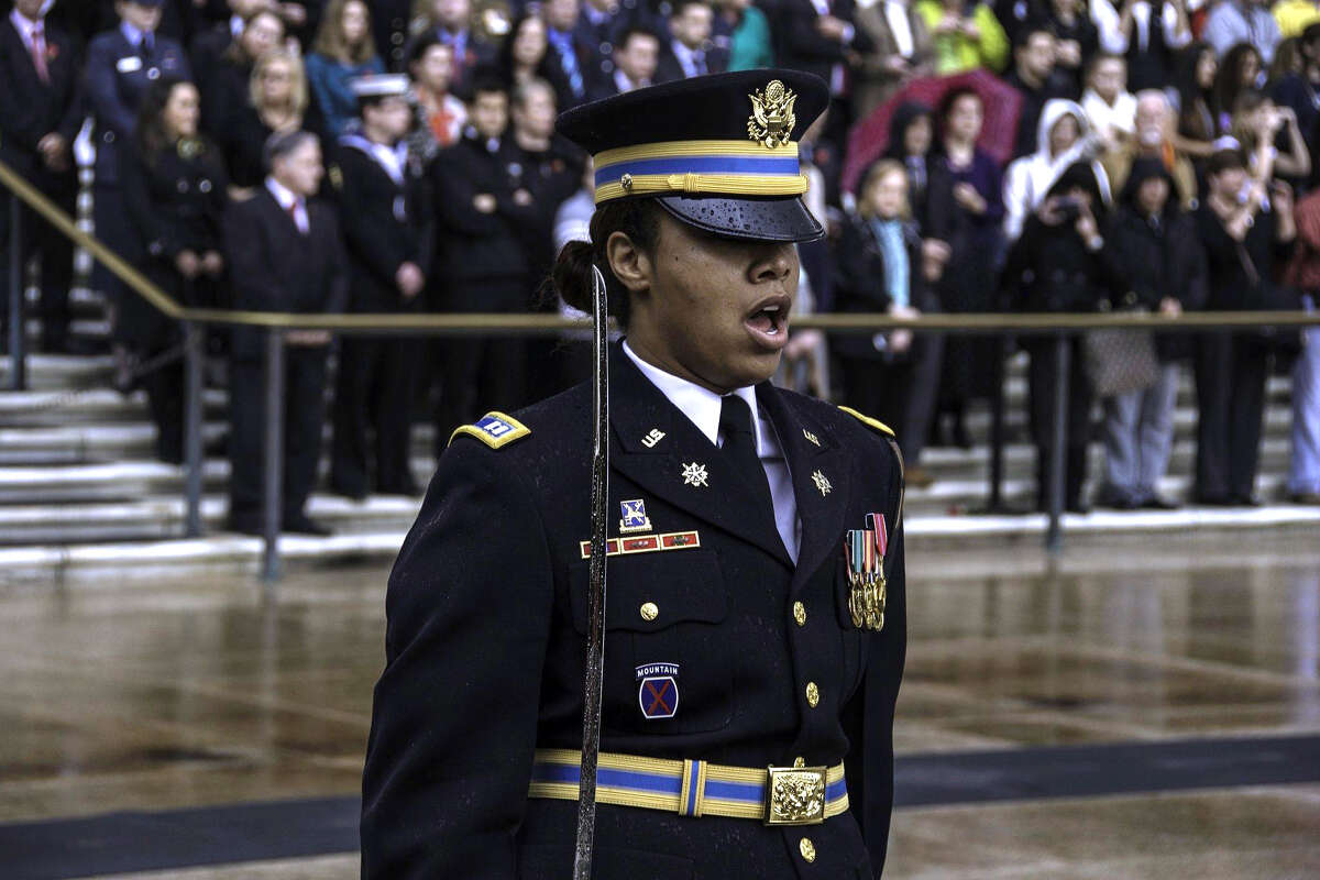 Capt. Marjana Bidwell, center, a native of Albany, will be the first woman to take command of a company in the U.S. Army's Third Infantry (The Old Guard) Regiment in a ceremony on Tuesday, June 2, 2015, at Joint Base Myer-Henderson Hall, Fort Meyer, Va. (U.S. Army photos)