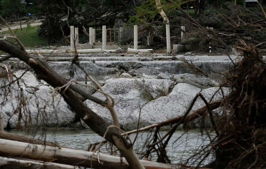 Columns that once supported a house where members of the McComb family reportedly stayed are seen from across the Blanco River in Wimberley. Photo: Kin Man Hui / San Antonio Express-News / ©2015 San Antonio Express-News