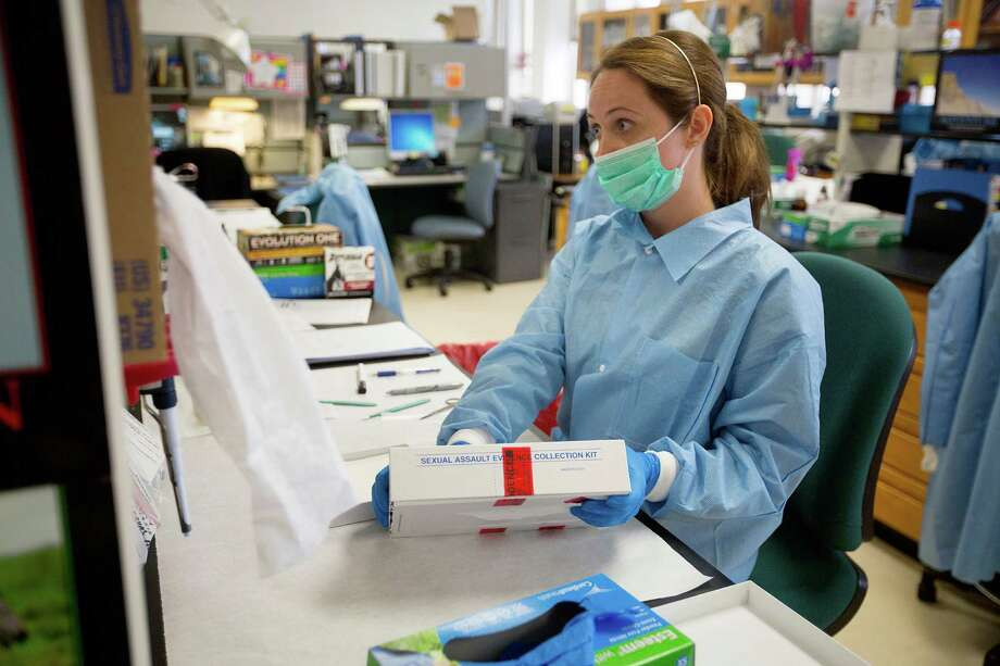 Kerry Todd, a criminalist in the forensic biology department, works on a rape kit at the Houston Forensic Science Center located at Houston Police Department  headquarters. Photo: Johnny Hanson, Staff / © 2014  Houston Chronicle