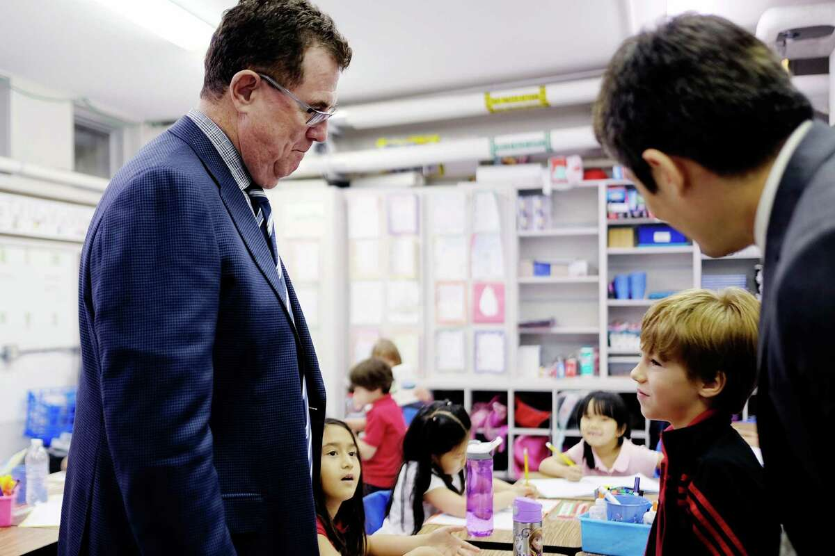 Take a by-the-numbers look at Terry Grier's time leading the Houston Independent School District. HISD Superintendent Terry Grier talks with a student during a May 2015 visit to the Mandarin Chinese Immersion School, a program he pitched to the school board four years ago.