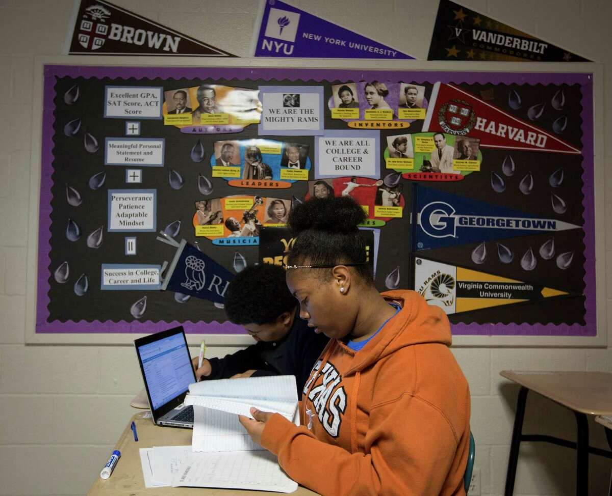 Kashmere High School's Kiana Sheffield, 17, and Zackary Hines, 17, study during their Advanced Placement physics class in March 2015. Teacher Adeeb Barqawi started the first AP physics class at the school.