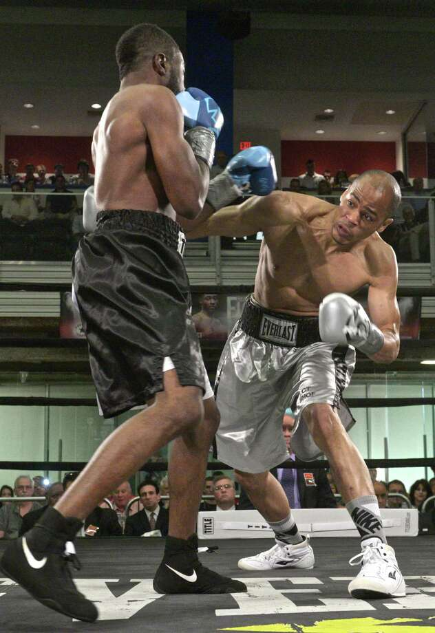 Jair Ramos, right, of Waterbury, lands a punch to the mid-section of Osnel Charles, of Atlantic City, NJ, in a junior welterweight fight during Danbury Fight Night, held at Danbury Arena, in Danbury, Conn, on Saturday night, May 30, 2015. Ramos won by decision. Photo: H John Voorhees III / The News-Times