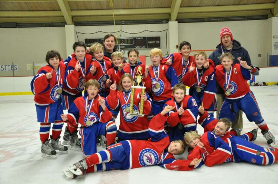 The Greenwich Skating Club Squirt A team captured the New England Regional Championship with a 4-3 win over East Haven last weekend at the University of Vermont's Gutterson Field House. Photo: Contributed Photo / Greenwich Time Contributed