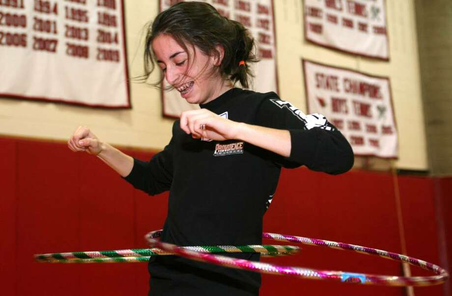 Greenwich High School student Elizabeth DeVivo, and Sheldon House member, keeps two hula hoops going at once during Friday's House Olympics which is organized by the student government to help foster school spirit. Photo: David Ames, David Ames/For Greenwich Time / Greenwich Time