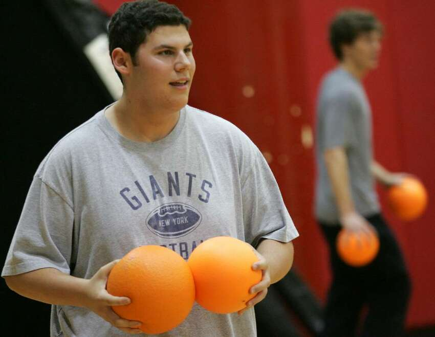 Greenwich High School student Will Stark, and Clark House member, gets prepared for the start of a dodge ball contest held during Friday's House Olympics which is an annuall event organized by the student government to help foster school spirit.