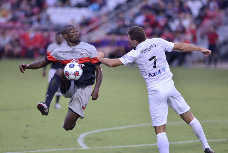 Scorpions Omar Cummings flies around Ft. Lauderdale's Frankie Sanfilippo during their North American Soccer League match Saturday at Toyota Field. Photo: Robin Jerstad, Freelance / San Antonio Express-News