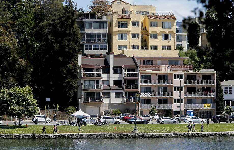 Neighbors across the street from Lake Merritt, had complained in the past when barbecues would send smoke to the upper levels of their homes, as seen on Sat. May 30, 2015, in Oakland, Calif. Regular patrols by the Oakland Police Department over the weekends has cut down on the use of barbecues . Photo: Michael Macor, The Chronicle