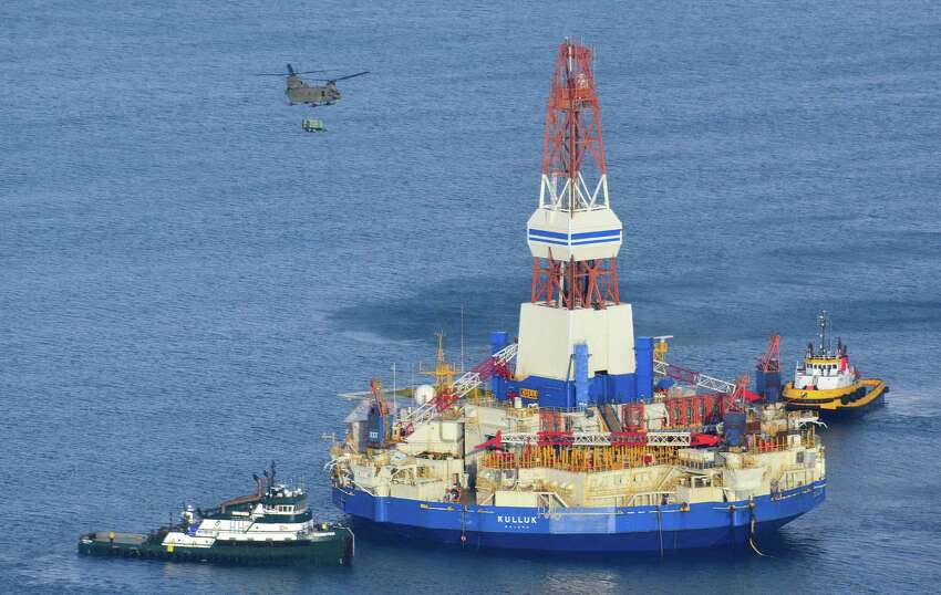 The Kulluk, which ran aground on Sitkalidak Island near Kodiak, was taken to Kiliuda Bay for repairs and a survey. A federal agency says the grounding of a Royal Dutch Shell PLC mobile offshore drilling rig in late 2012 was due to the company's inadequate assessment of risk involved in a winter tow across the treacherous Gulf of Alaska. The National Transportation Safety Board issued its ruling Thursday, May 28, 2015 on the Kulluk, which had been used to drill in the Beaufort Sea off Alaska's north coast. In this Jan. 7, 2013, file photo, a U.S. Army CH-47 Chinook helicopter flies over the Kulluk, the Shell floating drill rig off Kodiak Island in Alaska's Kiliuda Bay, as salvage teams conduct an in-depth assessment of its seaworthiness. (James Brooks/Kodiak Daily Mirror via AP, File)
