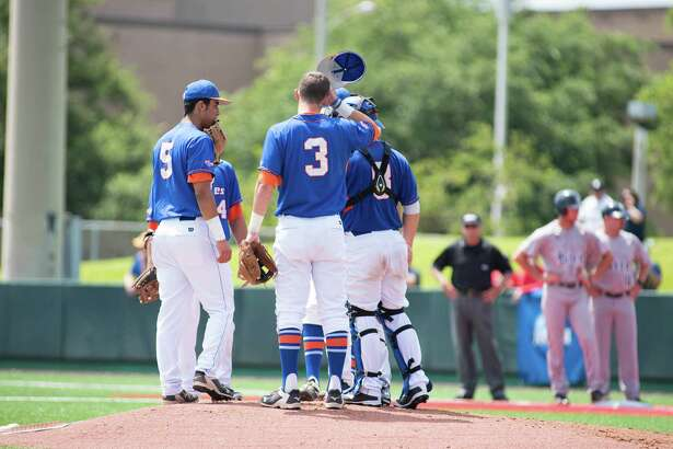 Houston Baptist players meet at the mound during the sixth inning of the first regional elimination game on May 31, 2015 at Cougar field at University of Houston.