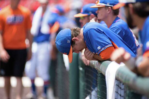 Houston Baptist players dejected after being eliminated from the playoffs on May 31, 2015 at Cougar field at University of Houston.