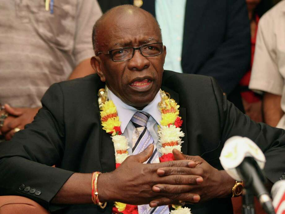 FILE - In this Thursday, June 2, 2011 file photo, suspended FIFA executive Jack Warner gestures during a news conference held shortly after his arrival at the airport in Port-of-Spain, in his native Trinidad and Tobago. Warner was one of the 14 people indicted Wednesday May 27, 2015 in the U.S. on corruption charges. Photo: Shirley Bahadur, AP / AP