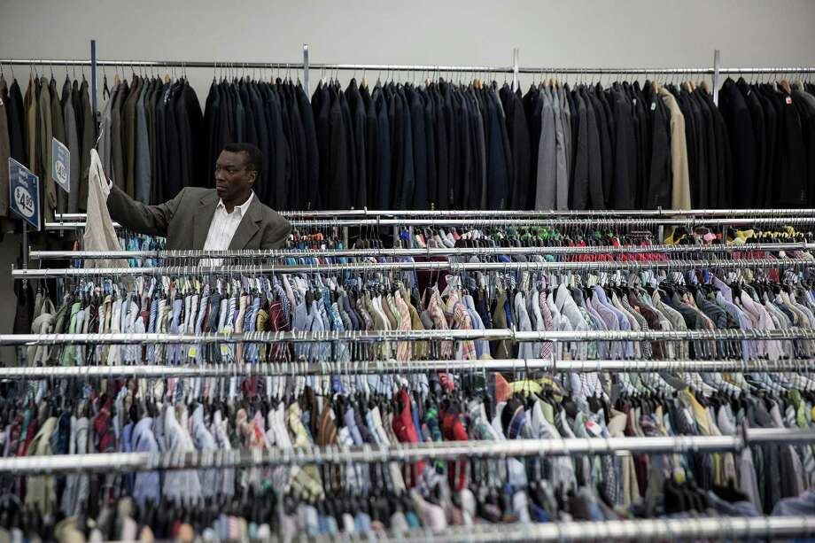 Racks of donated clothing are for sale at a Goodwill store in New YorkIf you paid more in taxes than you would have liked last month, you may well be looking to donate as much of your underused clothing as possible. Photo: Michael Appleton /New York Times / NYTNS