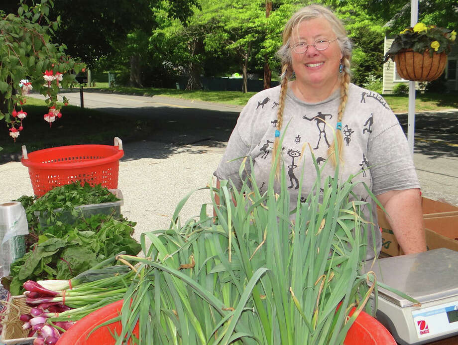 Punky Wilson selling fresh vegetables from Gazy Brothers Farm at the Greenfield Hill Farmers Market. Photo: Mike Lauterborn / Fairfield Citizen