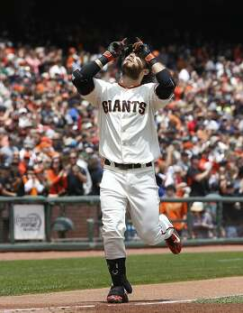 San Francisco Giants' Brandon Crawford, reacts after hitting a solo home run against the Atlanta Braves during the second inning of a baseball game, Sunday, May 31, 2015, in San Francisco. (AP Photo/Tony Avelar)