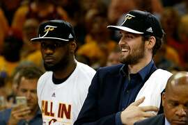 CLEVELAND, OH - MAY 26:  Kevin Love #0 and LeBron James #23 of the Cleveland Cavaliers celebrate after defeating the Atlanta Hawks during Game Four of the Eastern Conference Finals of the 2015 NBA Playoffs at Quicken Loans Arena on May 26, 2015 in Cleveland, Ohio. The Cavaliers defeated the Hawks 118-88. NOTE TO USER: User expressly acknowledges and agrees that, by downloading and or using this Photograph, user is consenting to the terms and conditions of the Getty Images License Agreement.  (Photo by Gregory Shamus/Getty Images)