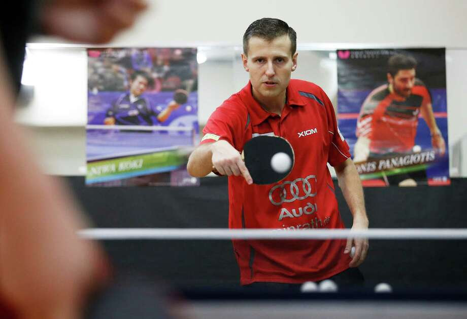 Polish table tennis pro Milosz Przybylik gives lessons to a student at the San Antonio Table Tennis Club on Tuesday, May 26, 2015. Przbylik is committed to stay through August to help boost the club and the local table tennis scene. (Kin Man Hui/San Antonio Express-News) Photo: Kin Man Hui, Staff / San Antonio Express-News / ©2015 San Antonio Express-News