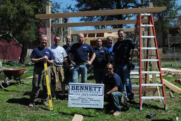 A team from Bennett Contracting built and installed a garden shed and grape arbor for local nonprofit Capital Roots in its Lincoln Park community garden in honor of the full-service home remodeling company's 100th anniversary. (Submitted photo)