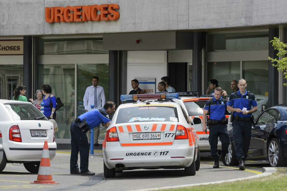 Police officers stand guard at the entrance of the Geneva University Hospital (HUG)in Geneva on May 31, 2015 while US Secretary of State John Kerry was receiving treatment there after a cycling accident.   US Secretary of State John Kerry broke his leg in a cycling accident in France and will fly back to the United States for treatment, cutting short a European trip. Kerry, 71, a keen cyclist, was hospitalised in the Swiss city of Geneva after the accident across the border in the French Alps, the State Department said.   AFP PHOTO / FABRICE COFFRINIFABRICE COFFRINI/AFP/Getty Images Photo: FABRICE COFFRINI, Staff / AFP / Getty Images / AFP