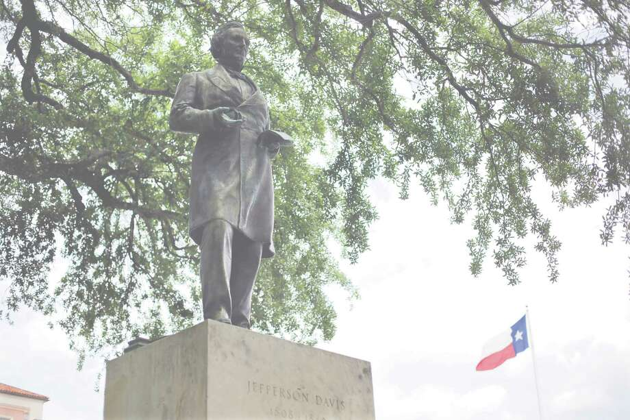 A statue of Jefferson Davis is seen on the University of Texas campus, Tuesday, May 5, 2015, in Austin, Texas. As University of Texas administrators consider a request to remove a statue that symbolizes the Confederacy, the number of memorials in Texas honoring the Confederate cause and its leaders continues to grow. (AP Photo/Eric Gay) Photo: Eric Gay, STF / AP