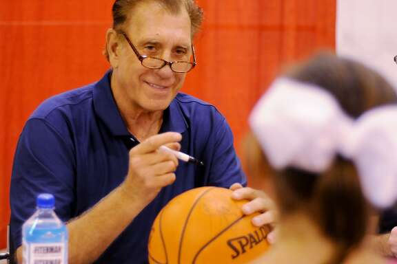 Former Houston Rockets Coach Rudy Tomjanovich smiles while signing an autograph at the Tristar 29th Annual Houston Summer Show at NRG Center Saturday May 30, 2015.(Dave Rossman photo)