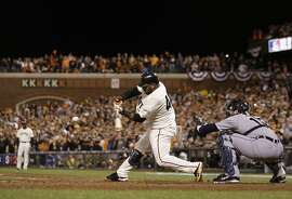 San Francisco Giants' Pablo Sandoval hits a single during the seventh inning of Game 1 of baseball's World Series against the Detroit Tigers Wednesday, Oct. 24, 2012, in San Francisco. Alex Avila is catching for the Tigers. (AP Photo/Marcio Jose Sanchez)