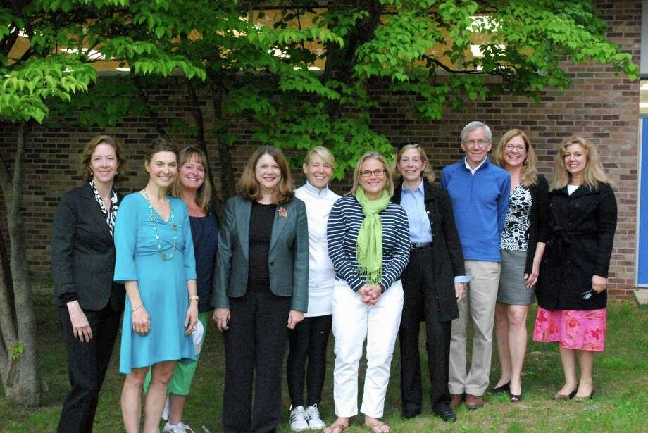 Darien Arts Center board members recently gathered to discuss plans for the DAC spring fundraiser, A Midsummer Nightís Celebration, taking place on June 20 from 6 p.m. to 9 p.m. Pictured are Deidre Hogan, Jessie Gilbert, Joan Carlo, Dana Fead, Sarah Ritchie, Christine Bang, DAC board president, Pam Heckel, Frank Huck, Amy Allen, DAC executive director, and Susan Helms.  A Midsummer Nightís Benefit to Celebrate the 40th Anniversary of the Darien Arts Center Photo: Contributed Photo / Darien News