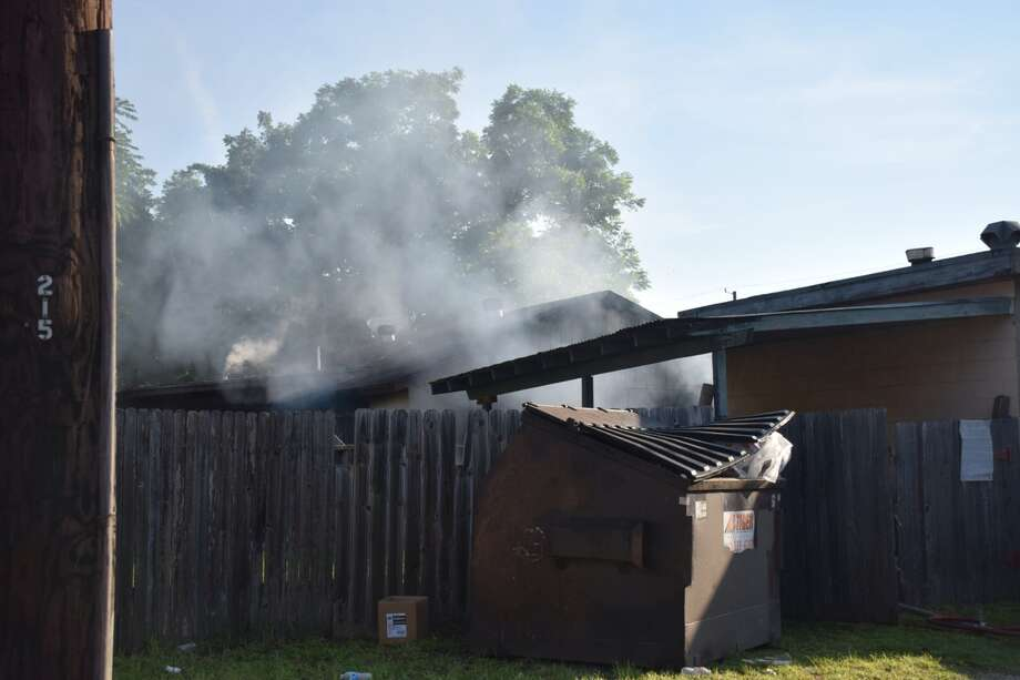 San Antonio Fire Department crews arrived to find heavy smoke pouring and fire shooting from a home on the South Side. Smoke was visible from downtown. Photo: Mark D. Wilson/San Antonio Express-News