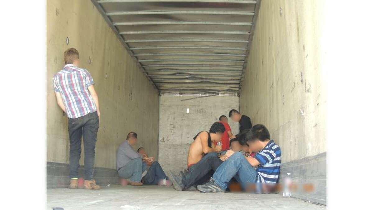 U.S. Border Patrol agents arrested 49 people believed to be in the country illegally after a traffic stop led them to a nearby residence last week. Texas Department of Public Safety officers discovered 18 undocumented immigrants (pictured) in a box trailer during a traffic stop at about 3 p.m. Thursday in Pharr, leading Border Patrol agents to a stash house in Palmhurst, where agents apprehended 31 people believed to be in the country illegally.