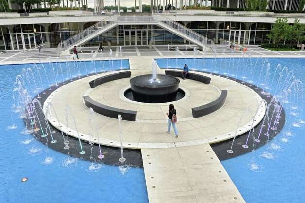 Freshman Stephon Mehu of Rockland County, right, takes a break in between classes to listen to some music while sitting on a bench in the new fountain at UAlbany on Thursday, Sept. 11, 2014 in Albany, N.Y. (Lori Van Buren / Times Union) Photo: Lori Van Buren, Albany Times Union