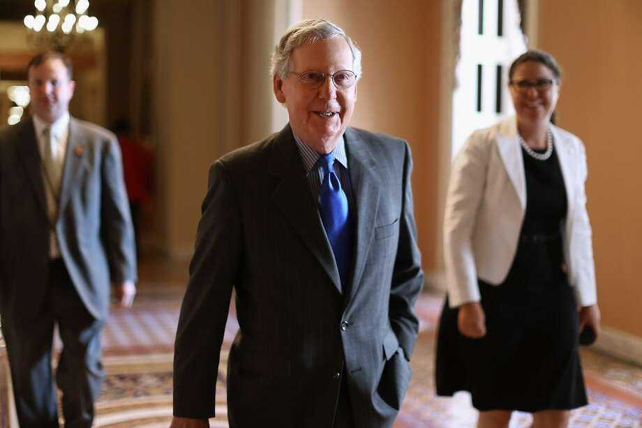 WASHINGTON, DC - JUNE 01:  Senate Majority Leader Mitch McConnell (R-KY) heads to the Senate Chamber at the U.S. Capitol June 1, 2015 in Washington, DC. In protest of the National Security Agency's sweeping program to collect U.S. citizens' telephone metadata, U.S. Sen. Rand Paul (R-KY) blocked an extension of some parts of the USA PATRIOT Act, allowing them to lapse at 12:01 a.m. Monday. The Senate will continue to work to restore the lapsed authorities by amending a House version of the bill and getting it to President Obama later this week.  (Photo by Chip Somodevilla/Getty Images) Photo: Chip Somodevilla, Getty Images