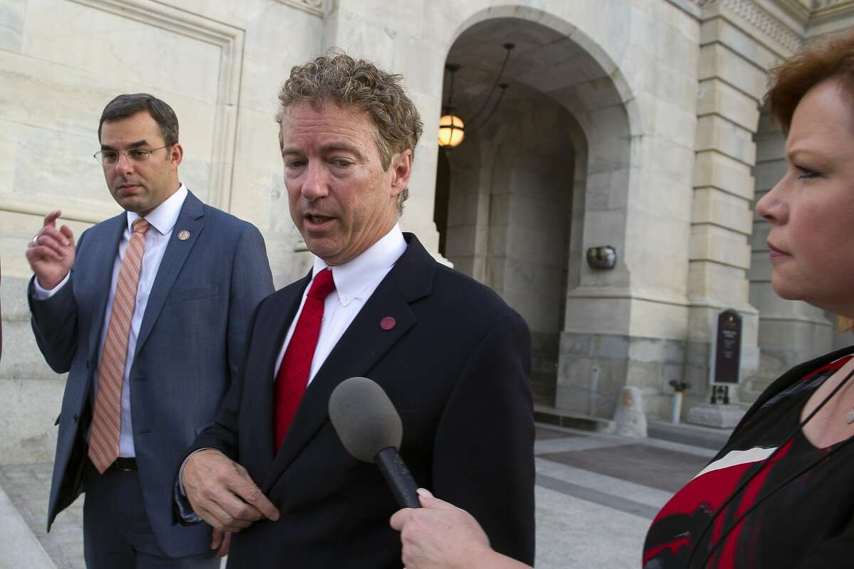 FILE - - In this May 31, 2015 file photo, Republican presidential candidate, Sen. Rand Paul, R-Ky., talks with a reporter as he leaves the Capitol Hill in Washington. For better or worse, Paul now stands apart from his rivals for the Republican presidential nomination. He thinks it's for the better, his and the nation's. More than a year in advance of the next election, most Republicans say it's for the worse, theirs and the country's. (AP Photo/Cliff Owen, File)