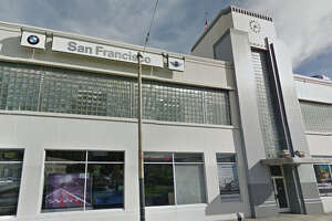 Car thief drives BMW out S.F. dealership window - Photo