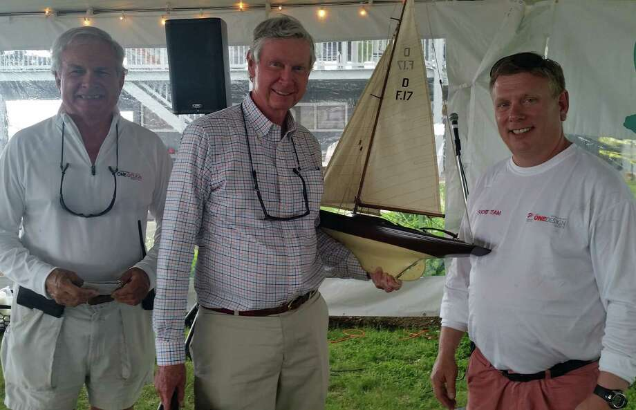 Halsey Bullen (left), Race Chairman for Westport's Cedar Point Yacht Club OneDesign Regatta, and CPYC Governor Steve Longo (right), flank Bill Sweetser of Annapolis, Maryland, skipper of the J/109 Rush, winner of the Rex Marine Trophy for Best Overall Performance in the 2015 Regatta, held last weekend in Westport. Photo: Deanna Polizzo/Contributed Photo / Westport News Contributed
