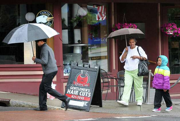 Pedestrians use umbrellas to shelter themselves from the much needed rain on Monday June 1, 2015 in Albany, N.Y. (Lori Van Buren / Times Union) Photo: Lori Van Buren