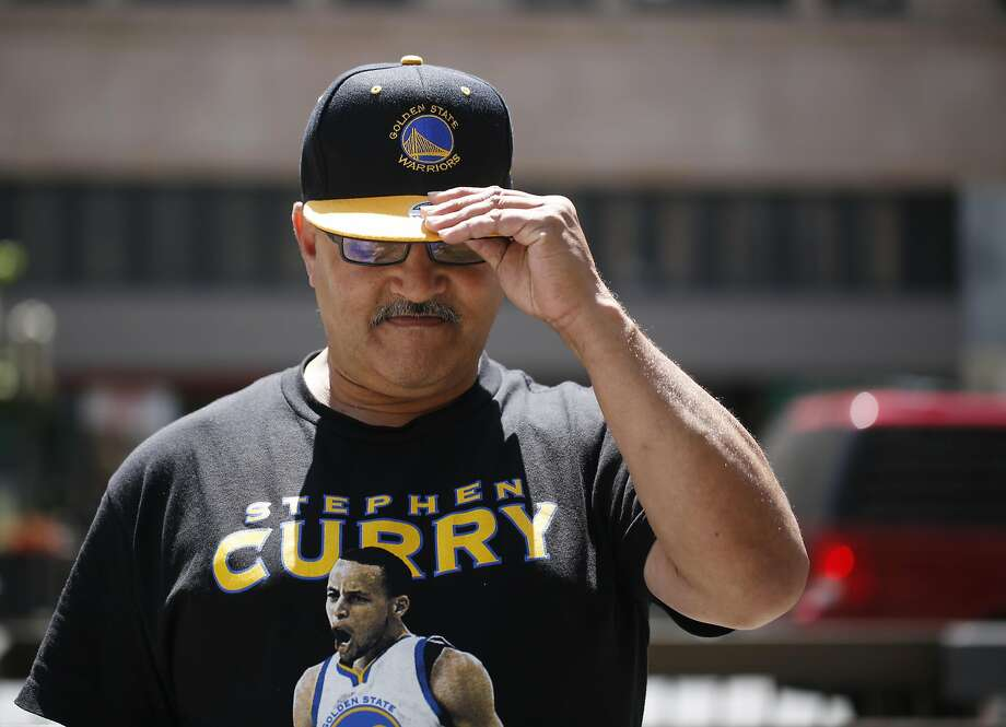 As the Golden State Warriors headed to the NBA finals, Stirling Capri adjusts his new Warriors hat on Broadway on Monday June 1, 2015 in Oakland, Calif. Photo: Mike Kepka, The Chronicle