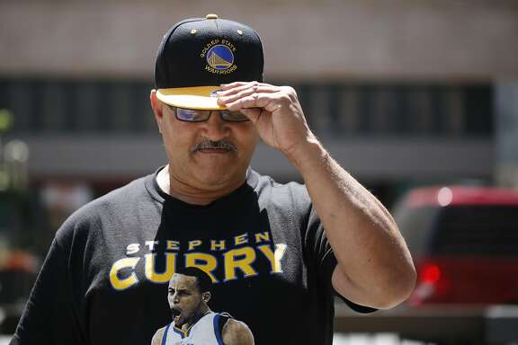 As the Golden State Warriors headed to the NBA finals, Stirling Capri adjusts his new Warriors hat on Broadway on Monday June 1, 2015 in Oakland, Calif.