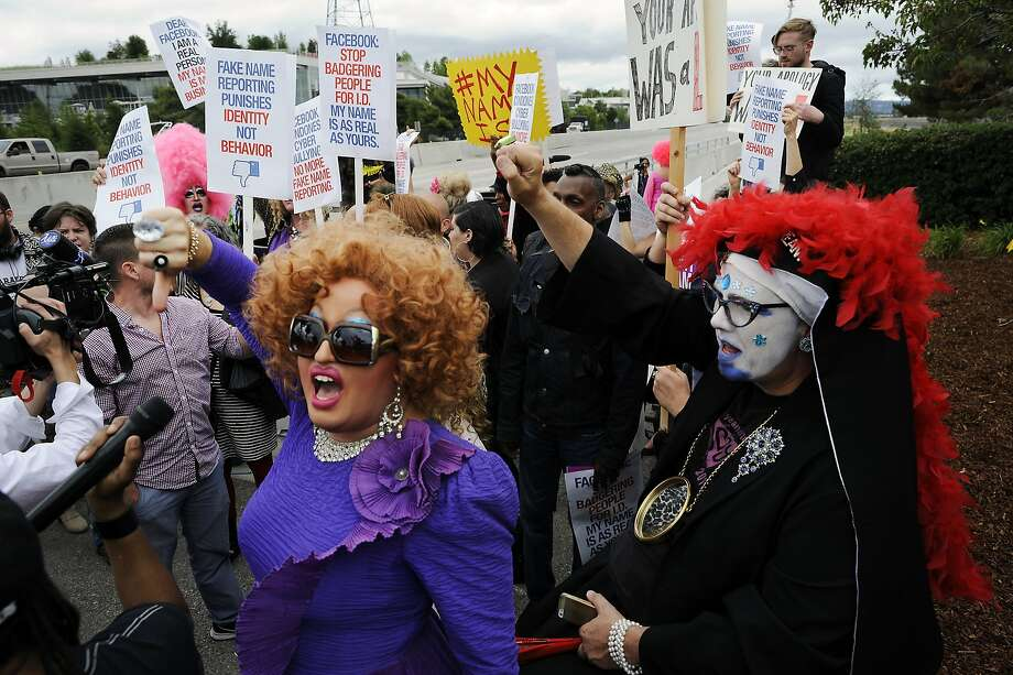 """Little Miss Hot Mess, left, and Sister Merry Peter yell as they join other members of the #MyNameIs Coalition in protest Facebook's so-called """"fake name policy"""" in front of their  headquarters in Menlo Park, CA Monday, June 1, 2015. Photo: Michael Short, Special To The Chronicle"""
