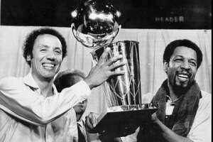 Seattle Supersonics head coach Lenny Wilkens and Fred Brown show off the 1979 NBA championship trophy.