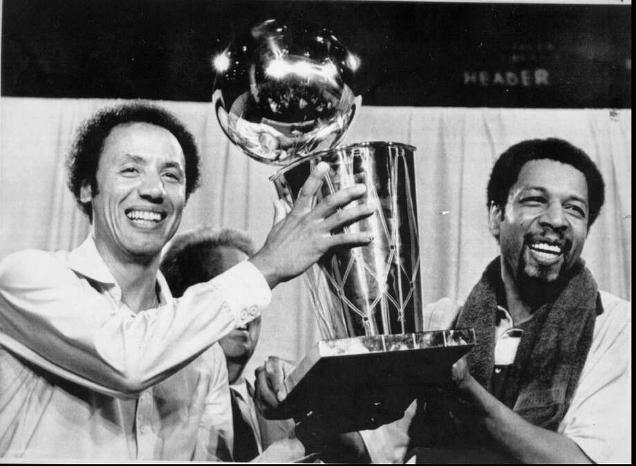 Seattle Supersonics head coach Lenny Wilkens and Fred Brown show off the 1979 NBA championship trophy. Photo: Seattle P-I File
