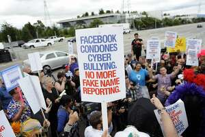 """Members of the #MyNameIs Coalition protests Facebook's so-called """"fake name policy"""" in front of their  headquarters in Menlo Park, CA Monday, June 1, 2015."""