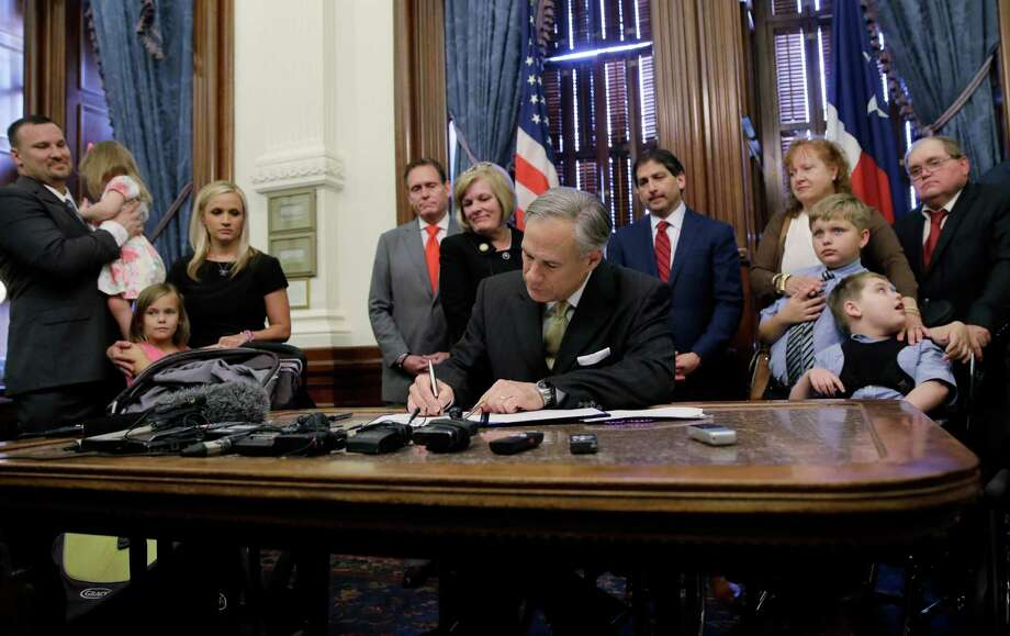 See some of the most prominent bills that managed to pass the Texas legislature this session. Texas Gov. Greg Abbott, front center, signs  SB 339, a bill allowing the medical use of low-THC cannabis, into law at the Texas Capitol, Monday, June 1, 2015, in Austin, Texas. Photo: Eric Gay, Associated Press / AP
