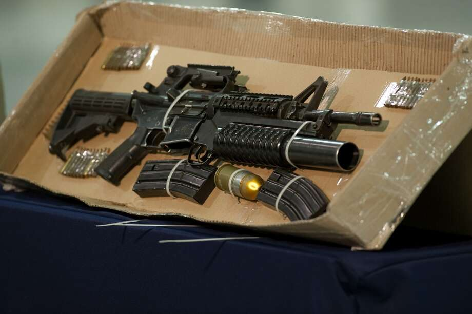 Firepower increaseAccording to reports, after 2008 more assault weapons were being retrieved such as this M4 assault rifle with a mounted M-203 grenade launcher that belonged to Edgar Valdez Villareal, aka 'La Barbie', of the Beltran Leyva drug cartel in 2010. Photo: ALFREDO ESTRELLA, AFP/Getty Images