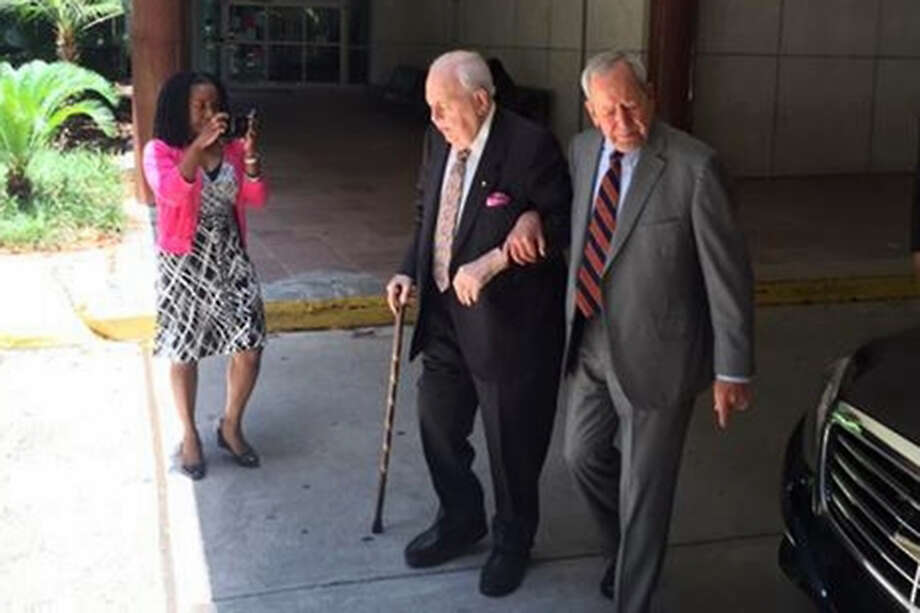 Tom Benson is assisted Monday as he enters Orleans Parish Civil District Court on Monday for the start of the proceedings focused on his competency. Man assisting Tom Benson is his lawyer, Phil Wittmann. He also was in attendance Tuesday. Photo: Travers Mackel /WDSU
